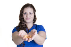 Health Worker with Handful of Pills Stock Photo