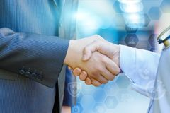 Health worker shakes hands with the patient . Royalty Free Stock Images