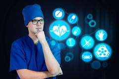 Health worker thinking Royalty Free Stock Photo