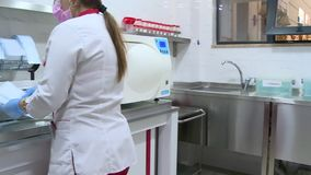 Health workers pack tools. Health workers pack and disinfect instruments stock video