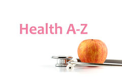 Health A-Z, health conceptual. Apple and stethoscope on white background with the word See Your Doctor, health conceptual Stock Photography