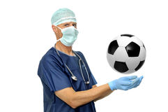 Healthcare. Doctor with soccer ball isolated in white Stock Photo
