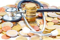 Healthcare. Stethoscope and many Euro Coins Stock Image