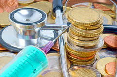 Healthcare. Stethoscope, Syringe and many Euro Coins Stock Photography