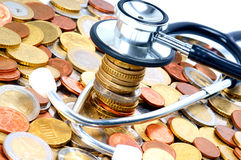 Healthcare. Stethoscope and many Euro Coins Stock Photography