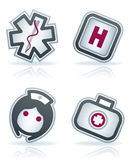 Healthcare. 4 icons in Healthcare 22 degrees blue icons set from left to right: hospital sign, hospital sign, nurse, firs aid kit Stock Photos