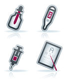 Healthcare. 4 icons in Healthcare 22 degrees blue icons set pictured here from left to right: bottle and dropper, electronic thermometer, syringe, oculist Royalty Free Stock Photos
