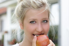 Healthcare. Close-up portrait of a beautiful teenager eating an apple Stock Photo
