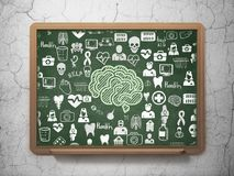Healthcare concept: Brain on School board background. Healthcare concept: Chalk Green Brain icon on School board background with  Hand Drawn Medicine Icons, 3D Royalty Free Stock Photography