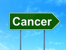Healthcare concept: Cancer on road sign background. Healthcare concept: Cancer on green road highway sign, clear blue sky background, 3D rendering Stock Images