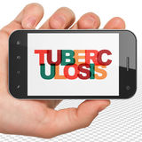 Healthcare concept: Hand Holding Smartphone with Tuberculosis on  display Royalty Free Stock Images