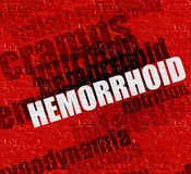 Healthcare concept: Hemorrhoid on Red Brick Wall . Royalty Free Stock Photography