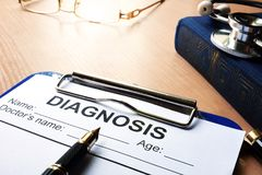 Medical diagnosis form in a clipboard. stock images