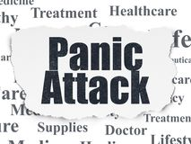 Healthcare concept: Panic Attack on Torn Paper background. Healthcare concept: Painted black text Panic Attack on Torn Paper background with  Tag Cloud Royalty Free Stock Photo
