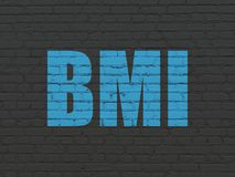 Healthcare concept: BMI on wall background. Healthcare concept: Painted blue text BMI on Black Brick wall background Stock Image