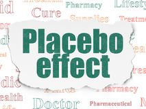 Healthcare concept: Placebo Effect on Torn Paper background. Healthcare concept: Painted green text Placebo Effect on Torn Paper background with  Tag Cloud Royalty Free Stock Photos