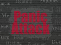 Healthcare concept: Panic Attack on wall background. Healthcare concept: Painted red text Panic Attack on Black Brick wall background with  Tag Cloud Stock Image