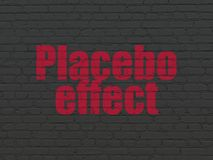 Healthcare concept: Placebo Effect on wall background. Healthcare concept: Painted red text Placebo Effect on Black Brick wall background Royalty Free Stock Image