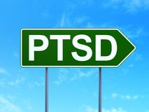 Healthcare concept: PTSD on road sign background. Healthcare concept: PTSD on green road highway sign, clear blue sky background, 3D rendering Royalty Free Stock Image