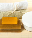 Healthcare Concept: soap, towels and Cream. Spa Concept: handmade soap, towels and Cream with oils lie on the bamboo mat Royalty Free Stock Photography
