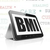 Healthcare concept: Tablet Computer with BMI on display. Healthcare concept: Tablet Computer with  black text BMI on display,  Tag Cloud background, 3D rendering Stock Photo