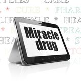 Healthcare concept: Tablet Computer with Miracle Drug on display Stock Image