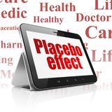 Healthcare concept: Tablet Computer with Placebo Effect on display. Healthcare concept: Tablet Computer with  red text Placebo Effect on display,  Tag Cloud Royalty Free Stock Photo