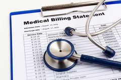 Healthcare cost concept with medical bill. Medical cost concept with stethoscope Royalty Free Stock Photo