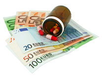 Healthcare cost. Medical pills and Euro bills Stock Photo