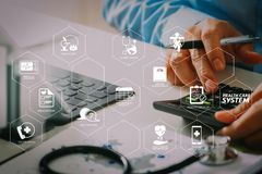 Healthcare costs and fees concept. Hand of smart doctor used a ca. Health care system diagram with health check and symptom on VR dashboard. Healthcare costs and stock image
