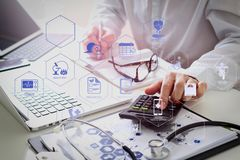 Healthcare costs and fees concept.Hand of smart doctor used a ca. Health care system diagram with health check and symptom on VR dashboard.Healthcare costs and stock image
