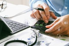 Healthcare costs and fees concept.Hand of smart doctor used a ca Royalty Free Stock Photos