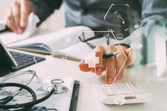 Healthcare costs and fees concept.Hand of smart doctor used a ca Stock Photography