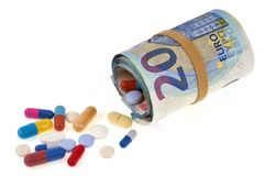Medicines coming out of a roll of euro banknotes royalty free stock images