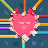 Healthcare flat concept. Healthcare concept with hands holding medical and pharmacy elements and heart in the middle flat vector illustration Royalty Free Stock Photography
