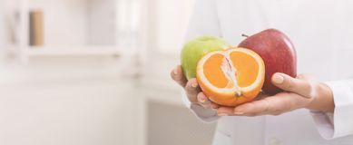 Unrecognizable nutritionist holding fresh fruit, copy space stock photography