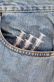 Healthcare medical 3 syringe in bag blue Jeans Stock Image