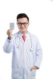 Healthcare and medical concept - asian mel doctor with blister p Royalty Free Stock Images