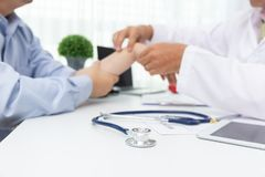 Healthcare and medical concept, Doctor explain wrist pain symptoms and medical treatment to patient in hospital.  royalty free stock photos