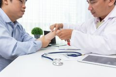 Healthcare and medical concept, Doctor explain wrist pain symptoms and medical treatment to patient in hospital.  stock photos