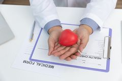 Healthcare and medical concept, Doctor holding heart ball and explain heart disease symptoms and medical treatment to patient in. Hospital royalty free stock photo