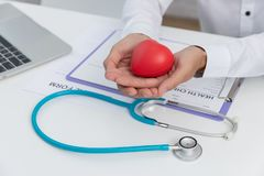 Healthcare and medical concept, Doctor holding heart ball and explain heart disease symptoms and medical treatment to patient in. Hospital royalty free stock images