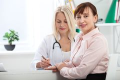 Healthcare and medical concept - doctor with patient in hospital. Doctor`s consultation Stock Photo