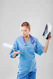 Healthcare and medical concept - female doctor with stethoscope Stock Photography