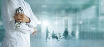 Healthcare and medical concept. Medicine doctor with stethoscope in hand and Patients come to the hospital background