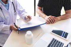 Healthcare and medical ethics concept, doctor explains prescription to victim diagnosis  giving a consultation and Patient. Listening intently in hospital royalty free stock photography