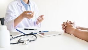 Health care and medical ethics concept, doctor explains prescription to victim diagnosis  giving a consultation and Patient. Listening intently in hospital royalty free stock images