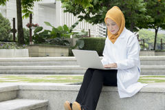 Healthcare, medical and radiology concept - pretty doctors looking at laptop Stock Photography