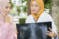 Healthcare, medical and radiology concept - pretty doctors looking at laptop Stock Photos