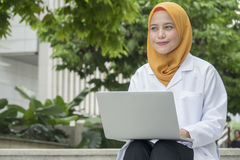 Healthcare, medical and radiology concept - pretty doctors looking at laptop Royalty Free Stock Images